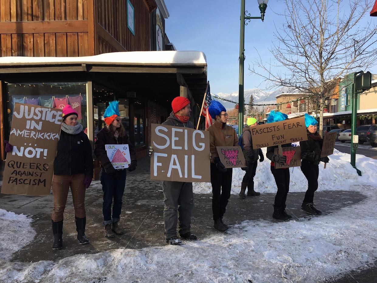 """Activists calling themselves """"Trolls Against Trolls"""" came from Missoula, Mont., to protest a threatened neo-Nazi march on Whitefish's main drag. (Photo: Andrew Romano/Yahoo News)"""