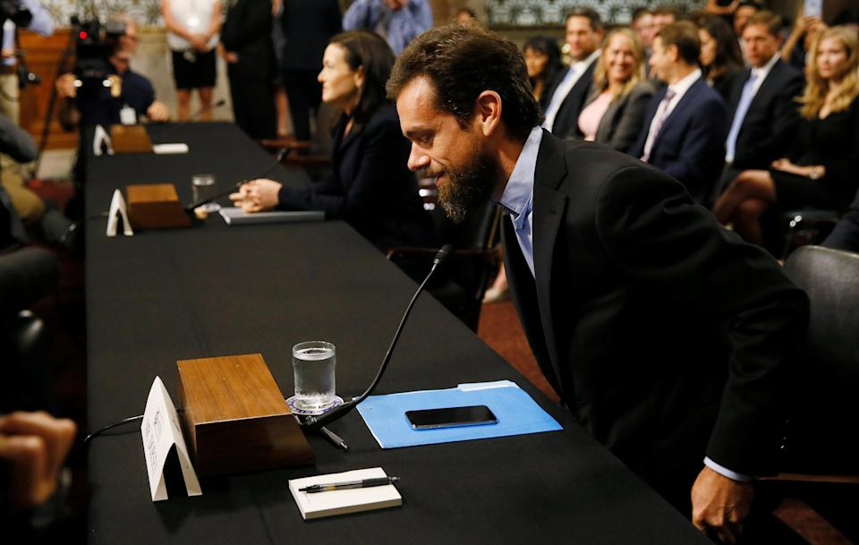 Twitter CEO Jack Dorsey takes his seat as he arrives with Facebook COO Sheryl Sandberg to testify before a Senate Intelligence Committee hearing on foreign influence operations on social media platforms on Capitol Hill in Washington, U.S., September 5, 2018. REUTERS/Jim Bourg