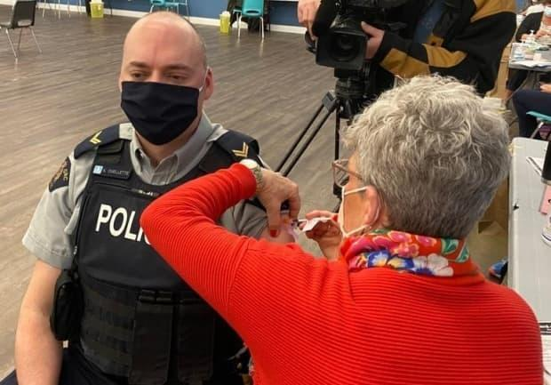 New Brunswick RCMP spokesperson Cpl. Hans Ouellette receives his first dose of the COVID-19 vaccine at a clinic for first responders last week.