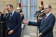Edouard Philippe, left, hands over to Jean Castex, whom few had ever heard of