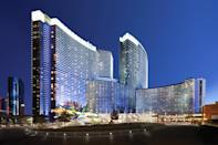 """<p><strong>How did it strike you on arrival?</strong><br> Aria is a sleek, curvilinear glass building, and when you walk in from the valet, you feel like you're in a monumental glass atrium. It was designed by Pelli Clarke Pelli Architects, using a lot of stone and glass. There's almost never a wait at registration, and the lobby feels so spacious that it never has that cramped, crowded feeling that other casinos have. There's a serene wall of water right before you walk inside, and monumental pieces of public art are all over. It's a totally contemporary-feeling space.</p> <p><strong>What's the crowd like?</strong><br> The people who are checking into Aria are generally keen on staying in a more modern building, and like the proximity to high-end shopping (it's in the same CityCenter complex as <a href=""""https://www.cntraveler.com/shops/las-vegas/the-shops-at-crystals?mbid=synd_yahoo_rss"""" rel=""""nofollow noopener"""" target=""""_blank"""" data-ylk=""""slk:Crystals"""" class=""""link rapid-noclick-resp"""">Crystals</a> at CityCenter). The rooms are also completely non-smoking (there's a serious fine if they catch you), so you don't have that lingering 1980s-era smoke smell that some casino rooms have, even when they claim to be nonsmoking. In general, guests at Aria have paid a premium over other hotels, so they're often professionals here on business, or well-heeled vacationers.</p> <p><strong>The good stuff: Tell us about your room.</strong><br> I've stayed in both a Deluxe Strip View King in Aria and a One Bedroom Aria Suite in its Sky Suites. The rooms in Aria proper are lovely: They're all good-sized (starting at 520 square feet), with huge upholstered headboards, high beds with firm mattresses, and dark woods and chrome finishes—all with floor-to-ceiling windows. The technology is great, too. Every room gets an iPad to control music, curtains and lights. If you pay the premium for Sky Suites, though, you get a lot of extras. There's a complimentary ride from the airport; private chec"""