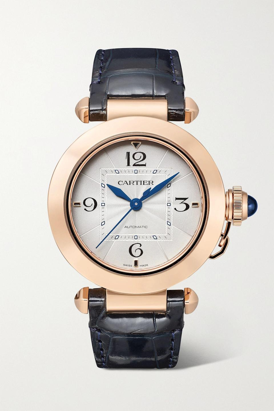 """<p><strong>Cartier</strong></p><p>net-a-porter.com</p><p><strong>$14300.00</strong></p><p><a href=""""https://go.redirectingat.com?id=74968X1596630&url=https%3A%2F%2Fwww.net-a-porter.com%2Fen-us%2Fshop%2Fproduct%2Fcartier%2Fjewelry-and-watches%2Fwatches%2Fpasha-de-cartier-automatic-35mm-18-karat-rose-gold-and-alligator-watch%2F23471478576690346&sref=https%3A%2F%2Fwww.harpersbazaar.com%2Ffashion%2Ftrends%2Fg37039475%2Fgifts-for-new-moms%2F"""" rel=""""nofollow noopener"""" target=""""_blank"""" data-ylk=""""slk:Shop Now"""" class=""""link rapid-noclick-resp"""">Shop Now</a></p><p>Don't make her sleep next to her phone to know what time it is.</p>"""