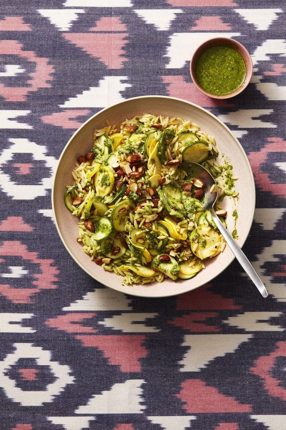 """<p>Marinating zucchini in white wine vinegar, then tossing it with pesto, really makes the summer vegetable shine. Serve it with <a href=""""https://www.goodhousekeeping.com/food-recipes/a28611486/seared-chicken-with-pesto-zucchini-orzo-recipe/"""" rel=""""nofollow noopener"""" target=""""_blank"""" data-ylk=""""slk:juicy chicken"""" class=""""link rapid-noclick-resp"""">juicy chicken</a> for a delicious main dish.</p><p><em><a href=""""https://www.goodhousekeeping.com/food-recipes/a28105024/pesto-zucchini-orzo-recipe/"""" rel=""""nofollow noopener"""" target=""""_blank"""" data-ylk=""""slk:Get the recipe for Pesto Zucchini Orzo »"""" class=""""link rapid-noclick-resp"""">Get the recipe for Pesto Zucchini Orzo »</a></em></p>"""
