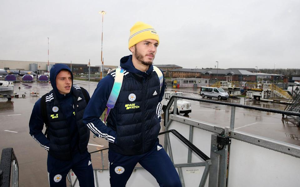 James Maddison of Leicester City and Harvey Barnes of Leicester City boards the plane as the Leicester City squad - Getty Images