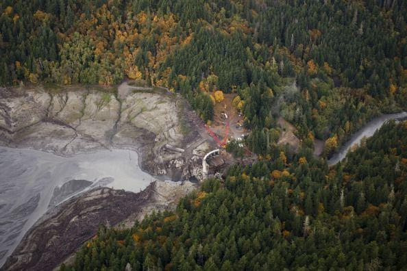"""<p>At 210 feet tall, the Glines Canyon Dam on Washington's Elwha River was the largest dam demolition ever. Built in 1927, it took a combination of excavators chipping away at the top of the dam layer by layer and then some good old detonation to remove it for good in 2014. As crews reached the lower portion of the concrete structure, they <a href=""""https://www.nationalgeographic.com/science/article/140826-elwha-river-dam-removal-salmon-science-olympic"""" rel=""""nofollow noopener"""" target=""""_blank"""" data-ylk=""""slk:sped up the removal process by bringing in explosives"""" class=""""link rapid-noclick-resp"""">sped up the removal process by bringing in explosives</a>, using a series of blasts to finish off the dam before then <a href=""""https://www.enr.com/articles/5830-largest-dam-removal-project-in-u-s-gets-under-way"""" rel=""""nofollow noopener"""" target=""""_blank"""" data-ylk=""""slk:completely engineering a revitalization"""" class=""""link rapid-noclick-resp"""">completely engineering a revitalization</a> of the river habitat that had been lost behind the dam for nearly 90 years.</p>"""