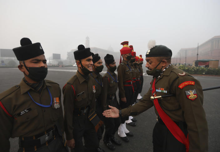 An Indian army instructor checks the marching posture of a soldier during practice for the upcoming Republic Day parade in New Delhi, India, Thursday, Jan. 21, 2021. Republic Day marks the anniversary of the adoption of the country's constitution on Jan. 26, 1950. Thousands congregate on Rajpath, a ceremonial boulevard in New Delhi, to watch a flamboyant display of the country's military power and cultural diversity. (AP Photo/Manish Swarup)