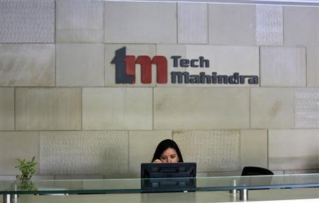 An employee sits at the front desk inside Tech Mahindra office building in Noida