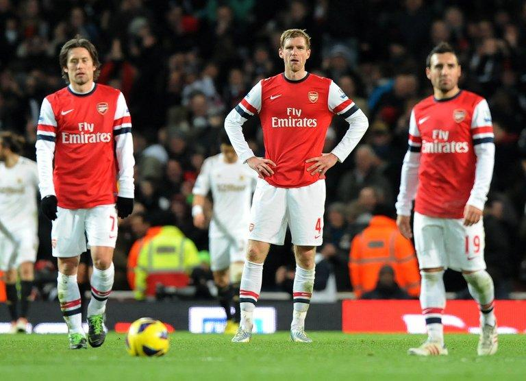 Arsenal's German defender Per Mertesacker reacts during an English Premier League football match on December 1, 2012. Mertesacker insists Arsenal will focus on Blackburn in the FA Cup, just 72 hours before German giants Bayern Munich arrive in north London for a last 16 Champions League first leg clash