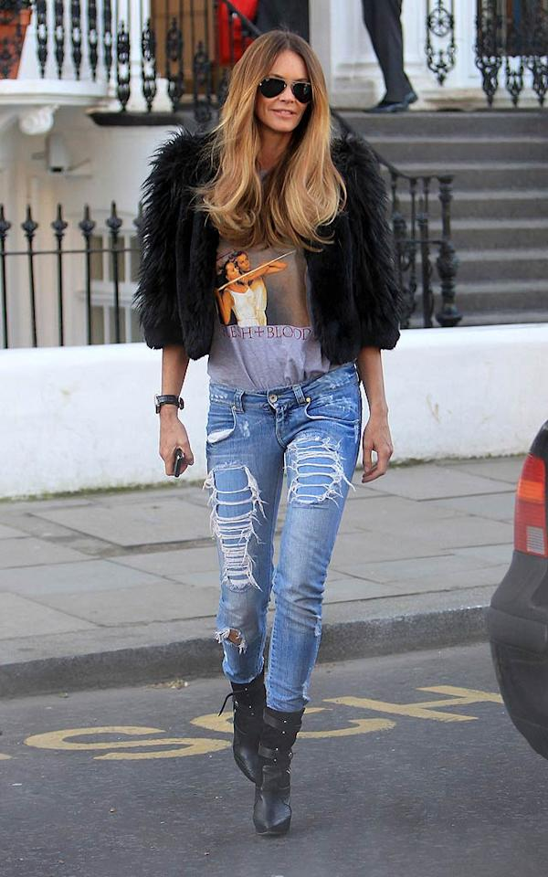 "Elle Macpherson is always effortlessly sexy. The 47-year-old supermodel/mommy recently rocked a Roxy Music tee, faux fur shrug, ripped jeans, and black boots while out and about in London. Casual wear has never looked better! <a href=""http://www.pacificcoastnews.com/"" target=""new"">PacificCoastNews.com</a> - February 8, 2011"