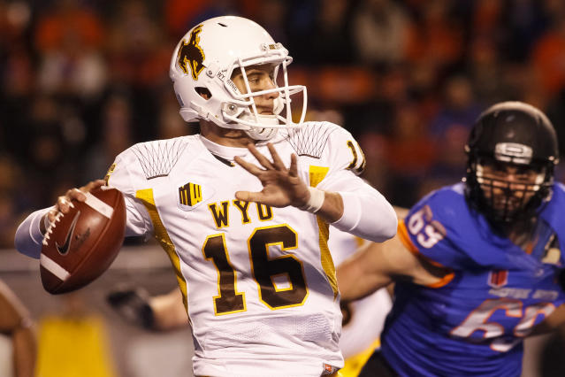 Wyoming quarterback Brett Smith (16) prepares to pass during the first half of an NCAA college football game against Boise State in Boise, Idaho, Saturday, Nov. 16, 2013. (AP Photo/Otto Kitsinger)