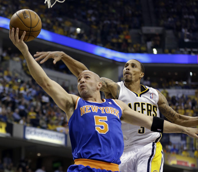 FILE - In this May 14, 2013 file photo, New York Knicks' Jason Kidd (5) shoots past Indiana Pacers' George Hill during the first half of Game 4 of an Eastern Conference semifinal NBA basketball playoff series in Indianapolis. The Knicks say Jason Kidd has decided to retire from the NBA after 19 seasons. His retirement Monday, June 3, 2013, comes two days after fellow 40-year-old Grant Hill, with whom Kidd shared Rookie of the Year honors in 1995, announced his retirement. (AP Photo/Darron Cummings, File)