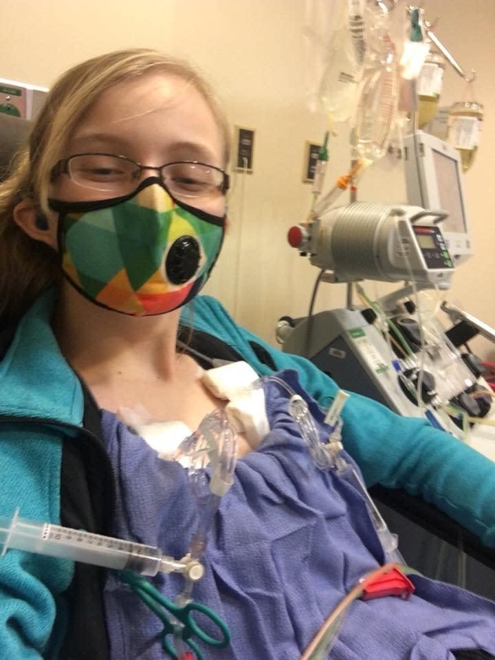 Meghan wearing a mask in the hospital.