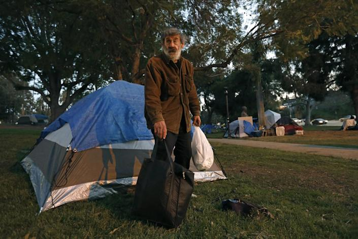 Frank Chiaro, 71, sets up a new tent at Echo Park.