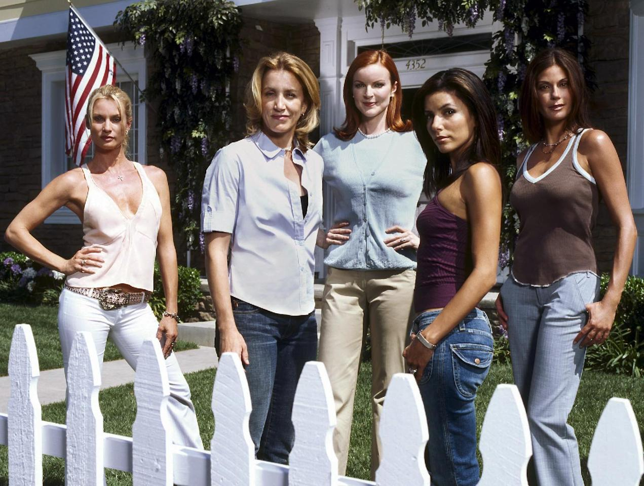 "FILE - In this 2004, file photo, originally released by ABC, the stars of the network's hit primetime series, ""Desperate Housewives,""from left, Nicollette Sheridan, Felicity Huffman, Marcia Cross, Eva Longoria and Teri Hatcher pose on the set in Los Angeles. Marc Cherry, who created the series, also created the Lifetime series, ""Devious Maids."" (AP Photo/ABC, Moshe Brakha, File)"