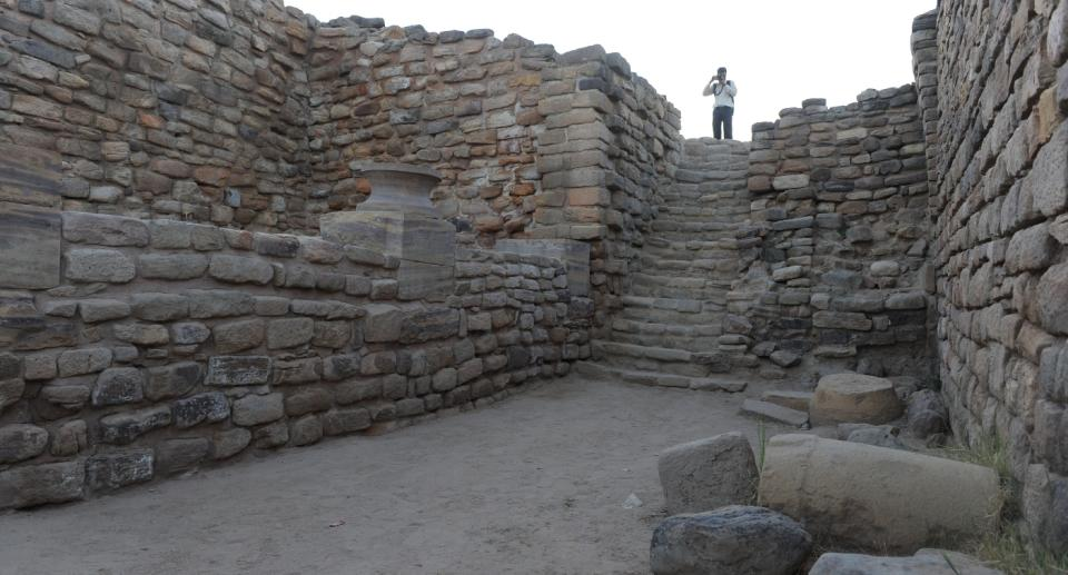 A tourist takes photos at the ancient Dholavira archaeological site in Kutch district in Gujarat. Dholavira has emerged as a major Harappan city remarkable for its exquisite town planning, monumental structures, aesthetic architecture and amazing water management and storage system. The Dholavira excavated site is maintained by the Archeological Survey of India. Photo: San Panthaky/AFP via Getty Images