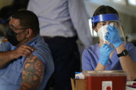 Medical personnel prepare a coronavirus vaccine to be administered to New York City firefighter emergency medical services personnel at the FDNY Fire Academy in New York, Wednesday, Dec. 23, 2020. (AP Photo/Seth Wenig)