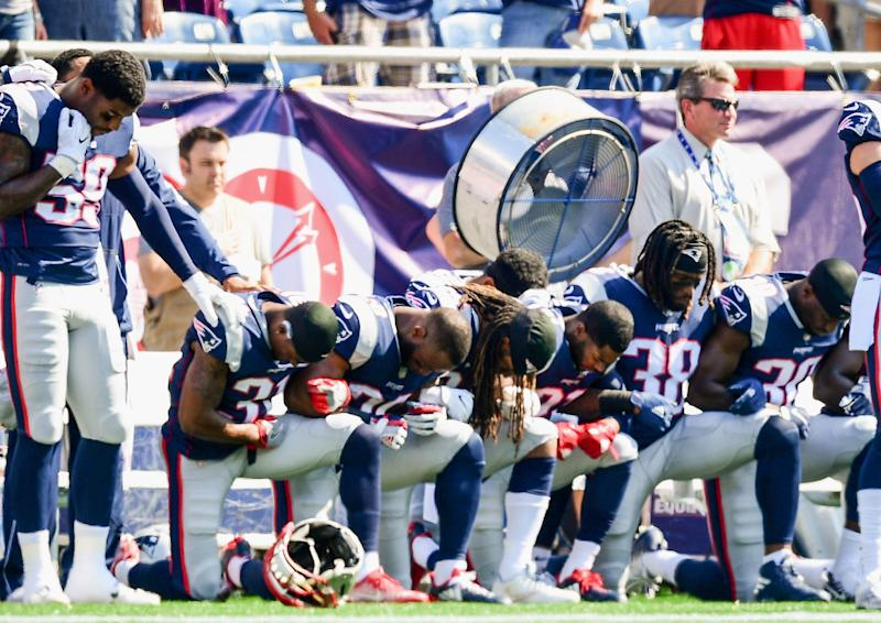 Some New England Patriots kneeled during the playing of the national anthem last season. (Getty Images)