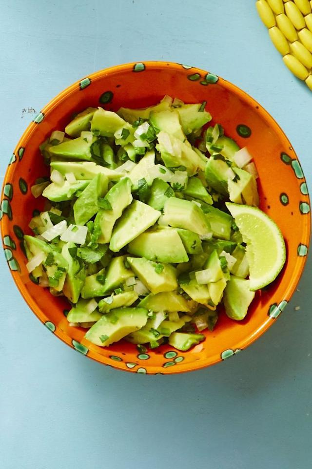 """<p>This quick appetizer is sure to get the party started! A chunky avocado dip like this one is sure to go fast. <em></em></p><p><em><em><a href=""""https://www.goodhousekeeping.com/food-recipes/easy/a19864878/chunky-guacamole-recipe/"""" target=""""_blank""""></a></em><em><a></a></em><em><a href=""""https://www.goodhousekeeping.com/food-recipes/easy/a19864878/chunky-guacamole-recipe/"""" target=""""_blank"""">Get the recipe for Chunky Guacamole </a></em><br></em></p>"""