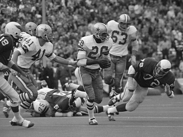 """File- This Nov. 1, 1970 file photo shows Dallas Cowboys cornerback Herb Adderley (26) running after intercepting a Philadelphia Eagles pass in the fourth quarter of an NFL game in Dallas, Texas. Tom Brady will soon slip on his sixth Super Bowl ring, and Herb Adderley is the only other man on the planet who can relate to that level of success as the National Football League celebrates its 100th season. """"It's going to be a long time, another 100 years, before somebody wins himself six titles,"""" said Adderley, the Hall of Fame cornerback for Vince Lombardis great Green Bay Packers teams of the 1960s. (AP Photo/File)"""