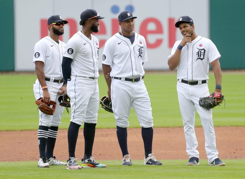 Detroit Tigers' Willi Castro (49) Niko Goodrum (28) Jonathan Schoop (8) and Jeimer Candelario (46) talk during a break in the action against the Cleveland Indians at Comerica Park, Sunday, Aug. 16, 2020.