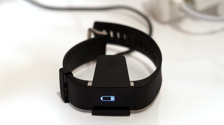 A plastic clamp charges up the Fitbit for six days.