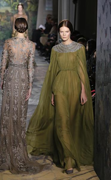 Models present creatsions as part of the Valentino Spring-Summer 2014 Haute Couture fashion collection, presented Wednesday, Jan. 22, 2014 in Paris. (AP Photo/Jacques Brinon)