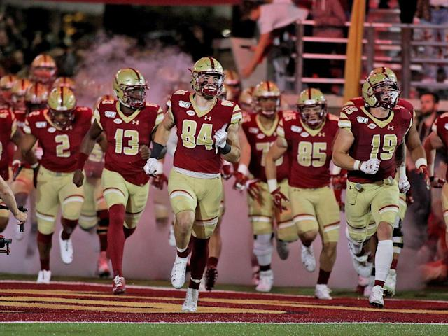 <p>Boston College tight end Jake Burt #84 leads BC out of the tunnel before the Eagles' game vs. Kansas at Boston College Alumni Stadium in Chestnut Hill, MA on Sept. 13, 2019.</p>