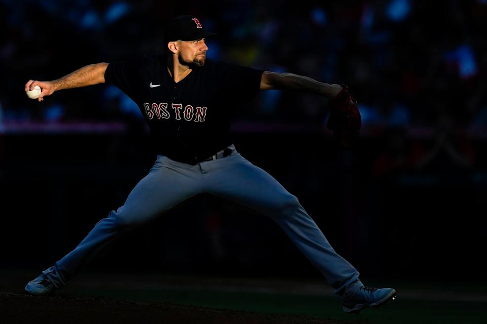 A shaft of light falls on Boston Red Sox starting pitcher Nathan Eovaldi (17) as he throws during the second inning of a baseball game against the Los Angeles Angels Tuesday, July 6, 2021, in Anaheim, Calif. (AP Photo/Ashley Landis)
