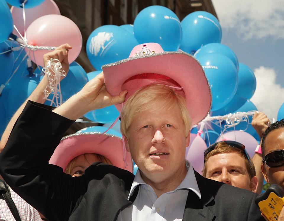 LONDON - JULY 05:  London Mayor Boris Johnson wears a pink stetson hat at the Gay Pride parade on July 5, 2008 in London, England. The parade consists of celebrities, floats, and performers celebrating the UK's largest gay and lesbian festival.  (Photo by Peter Macdiarmid/Getty Images)