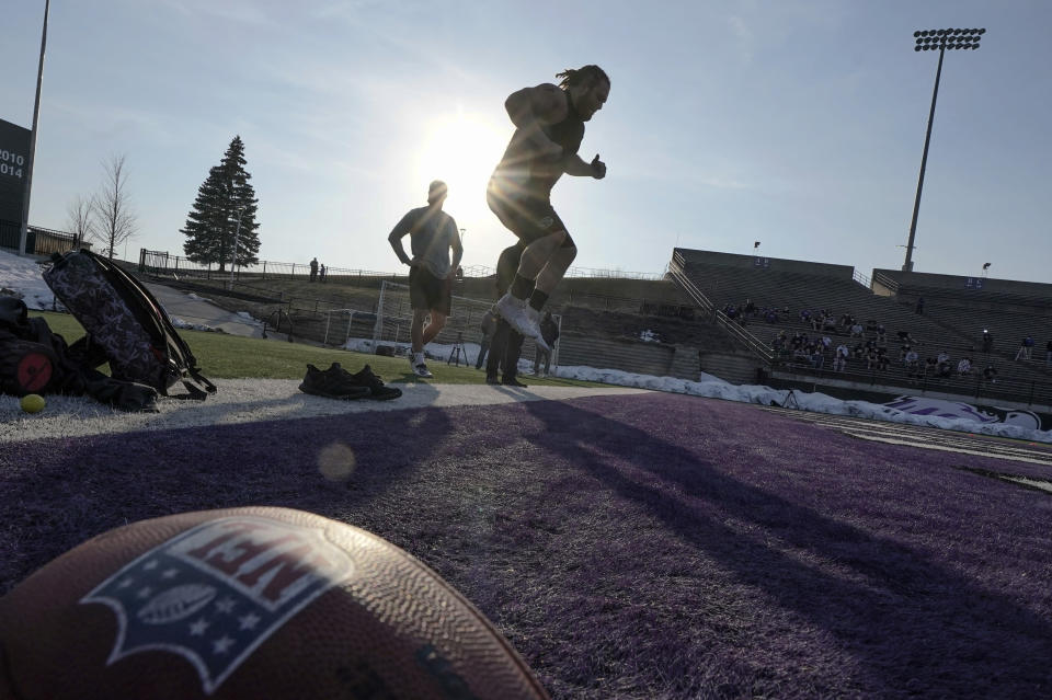 UW Whitewater lineman Quinn Meinerz jumps as he warms up at the school's pro football day Tuesday, March 9, 2021, in Whitewater, Wisc. The only FCS teams hosting pro days this year were Central Arkansas, North Dakota State and South Dakota State. Division III Wisconsin-Whitewater held one only because its Senior Bowl revelation, offensive lineman Quinn Meinerz, warranted another look after his team did not play in the fall. (AP Photo/Morry Gash)