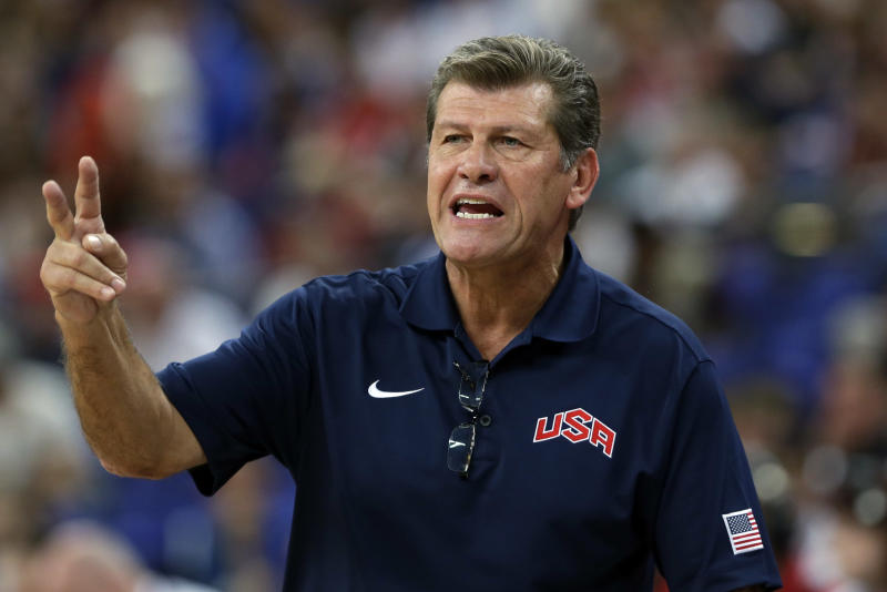 FILE - In this April 11, 2012 file photo, United States coach Geno Auriemma talks to his players during a women's gold medal basketball game against France at the 2012 Summer Olympics in London. A New York City judge has dismissed a discrimination and assault lawsuit against University of Connecticut women's basketball coach Auriemma and USA Basketball. NBA security official Kelley Hardwick had sued in June. She alleged she was removed from the USA women's basketball team's security detail at the London Olympics last year after spurning sexual advances from Auriemma.  (AP Photo/Eric Gay, File)