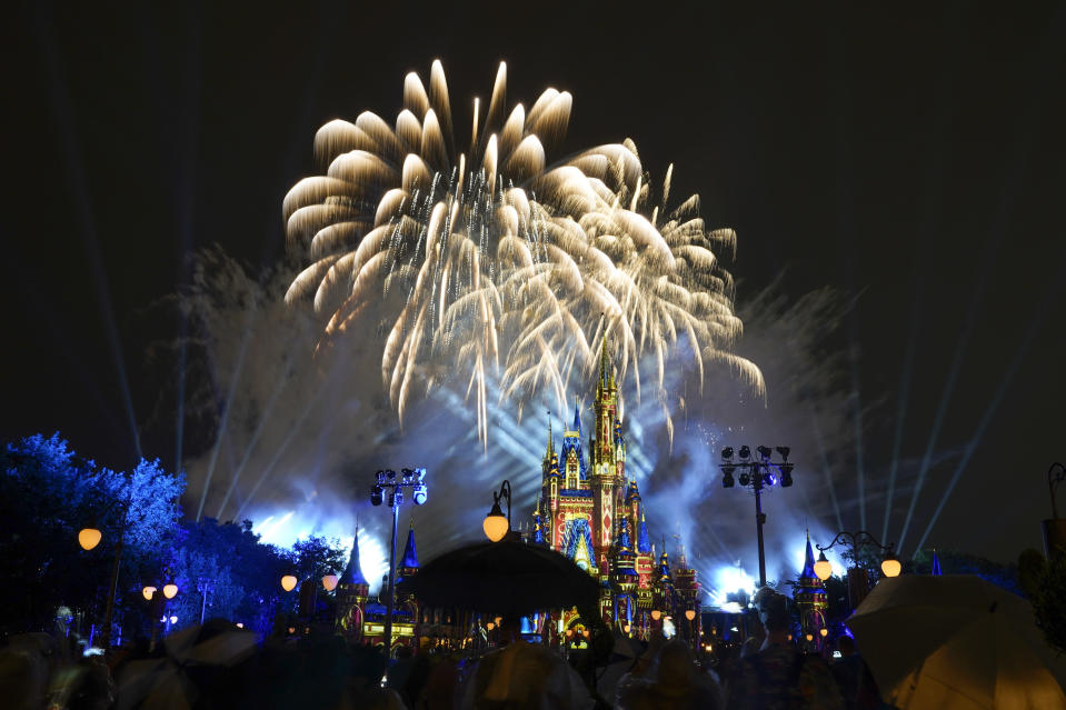After a shutdown because of the coronavirus, fireworks fill the sky for the first time in 15 months at the Magic Kingdom at Walt Disney World Thursday, July 1, 2021, in Lake Buena Vista, Fla. (AP Photo/John Raoux)