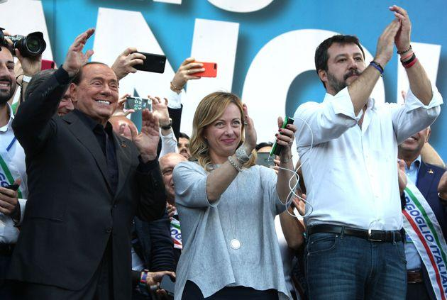 ROME ITALY OCTOBER 19 2019: (From L) Leader of Italy's liberal-conservative party Forza Italia, Silvio Berlusconi, leader of Italy's conservative party Brothers of Italy, Giorgia Meloni and leader of Italy's far-right League party, Matteo Salvini acknowledge supporters at the end of a joint rally against the government in Rome.- PHOTOGRAPH BY Marco Ravagli / Barcroft Media (Photo credit should read Marco Ravagli / Barcroft Media via Getty Images)