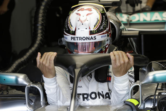 Mercedes driver Lewis Hamilton of Britain sits in his car cockpit in the pit lane during the first practice session for the Monaco Formula One Grand Prix at the Monaco racetrack, in Monaco, Thursday, May 24, 2018. The Monaco Grand Prix will be held on Sunday, May 27. (AP Photo/Claude Paris)