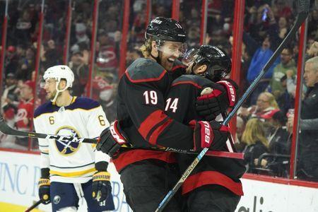 Jan 11, 2019; Raleigh, NC, USA; Carolina Hurricanes right wing Justin Williams (14) its congratulated by defenseman Dougie Hamilton (19) after his second period goal against the Buffalo Sabres at PNC Arena. Mandatory Credit: James Guillory-USA TODAY Sports