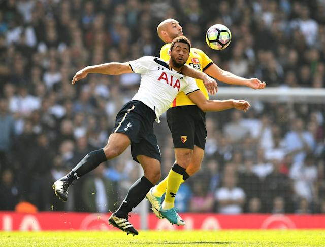 <p>Mousa Dembele is denied by Nordin Amrabat </p>