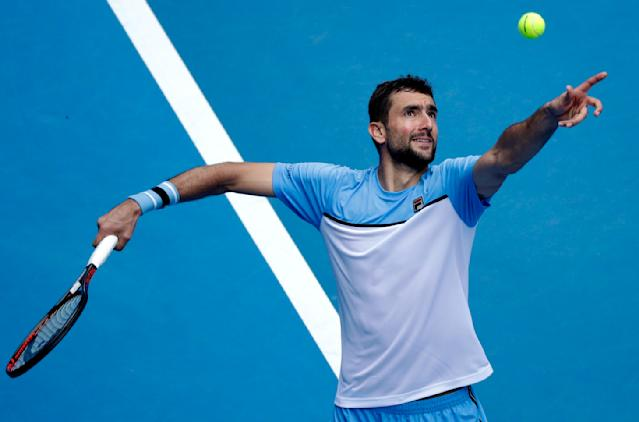 Croatia's Marin Cilic serves to United States' Mackenzie McDonald during their second round match at the Australian Open tennis championships in Melbourne, Australia, Wednesday, Jan. 16, 2019. (AP Photo/Kin Cheung)