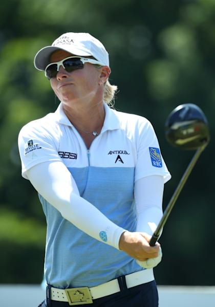 Canada's Alena Sharp fired a seven-under par 64 to share the lead after Thursday's opening round of the LPGA Marathon Classic