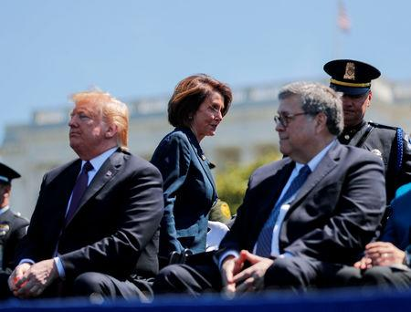 FILE PHOTO: Speaker of the House Nancy Pelosi walks behind U.S. President Donald Trump and U.S. Attorney General William Barr as they all attend the 38th Annual National Peace Officers Memorial Service on Capitol Hill in Washington, U.S., May 15, 2019. REUTERS/Carlos Barria/File Photo