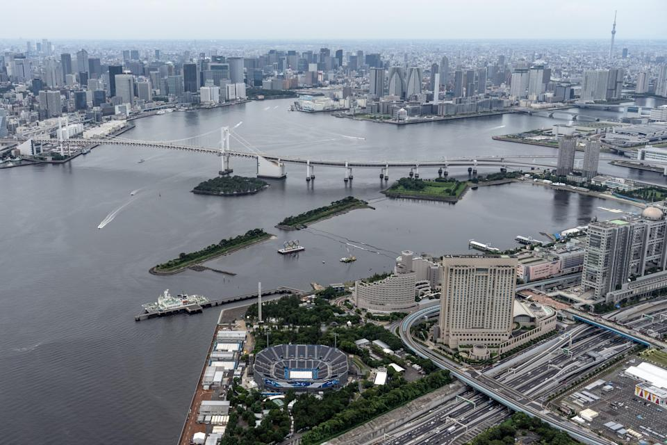 Tokyo Bay, Odaiba Marine Park and the Tokyo Olympic beach volleyball stadium are pictured from a helicopter on 26 June 2021 in Tokyo, Japan (Getty Images)