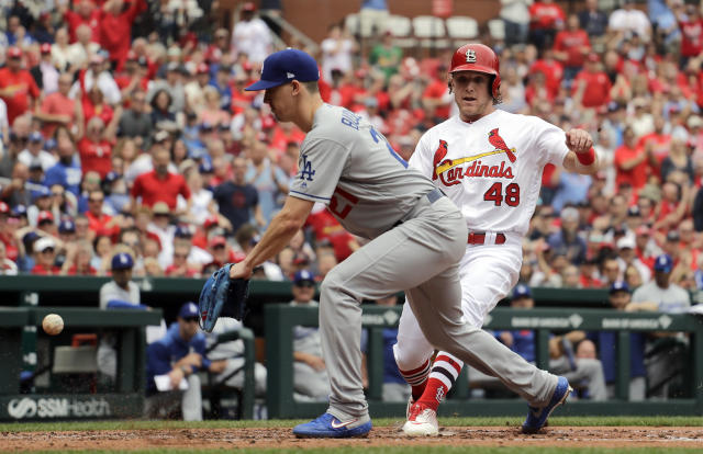 St. Louis Cardinals' Harrison Bader (48) scores on a wild pitch by Los Angeles Dodgers starting pitcher Walker Buehler as Buehler covers home during the second inning of a baseball game Thursday, April 11, 2019, in St. Louis. (AP Photo/Jeff Roberson)