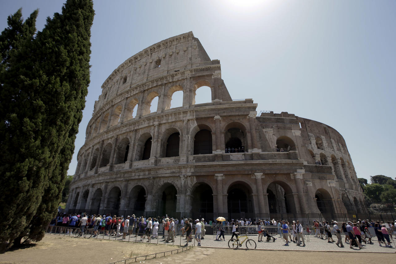 FILE -- In this July 1, 2016 file photo tourists visit the ancient Roman Colosseum, in Rome. Italy's culture minister Dario Franceschini said Tuesday, July 25, 2017, that the international search for a new director for Rome's Colosseum resumes after a challenge by the city was overruled by a tribunal. As part of Minister Dario Franceschini's efforts to modernize Italy's museums, for the first time non-Italians have been hired to head some of the art-rich nation's prestigious museums, like the Uffizi in Florence. (AP Photo/Andrew Medichini)