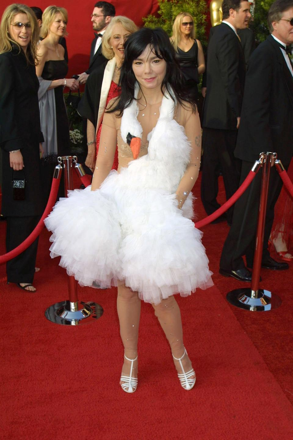 """<p>Björk's """"swan dress"""" became a global sensation for its offbeat design. The quirky Icelandic singer even stopped several times to """"lay eggs"""" on the red carpet for bewildered spectators. Although the look was blasted by fashion critics, Björk maintains that the dress was merely a joke intended to """"take the piss"""" out of the event. """"I was actually amazed at how many people thought I was serious,"""" she told the <a href=""""https://www.thetimes.co.uk/article/bjork-again-2d37mrbvphv"""" rel=""""nofollow noopener"""" target=""""_blank"""" data-ylk=""""slk:Sunday Times"""" class=""""link rapid-noclick-resp""""><em>Sunday Times</em></a> in 2004. """"I didn't mean to cause a riot.""""</p>"""