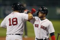 Boston Red Sox's Mitch Moreland (18) celebrates his two-run home run with Alex Verdugo during the third inning of a baseball game against the Toronto Blue Jays, Friday, Aug. 7, 2020, in Boston. (AP Photo/Michael Dwyer)