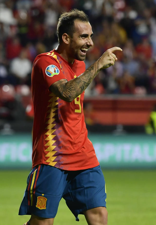Spain's Paco Alcacer celebrates after scoring his side's fourth goal during the Euro 2020 group F qualifying soccer match between Spain and Faroe Islands at the Molinon, stadium in Gijon, Spain, Sunday, Sept. 8, 2019. (AP Photo/Alvaro Barrientos)