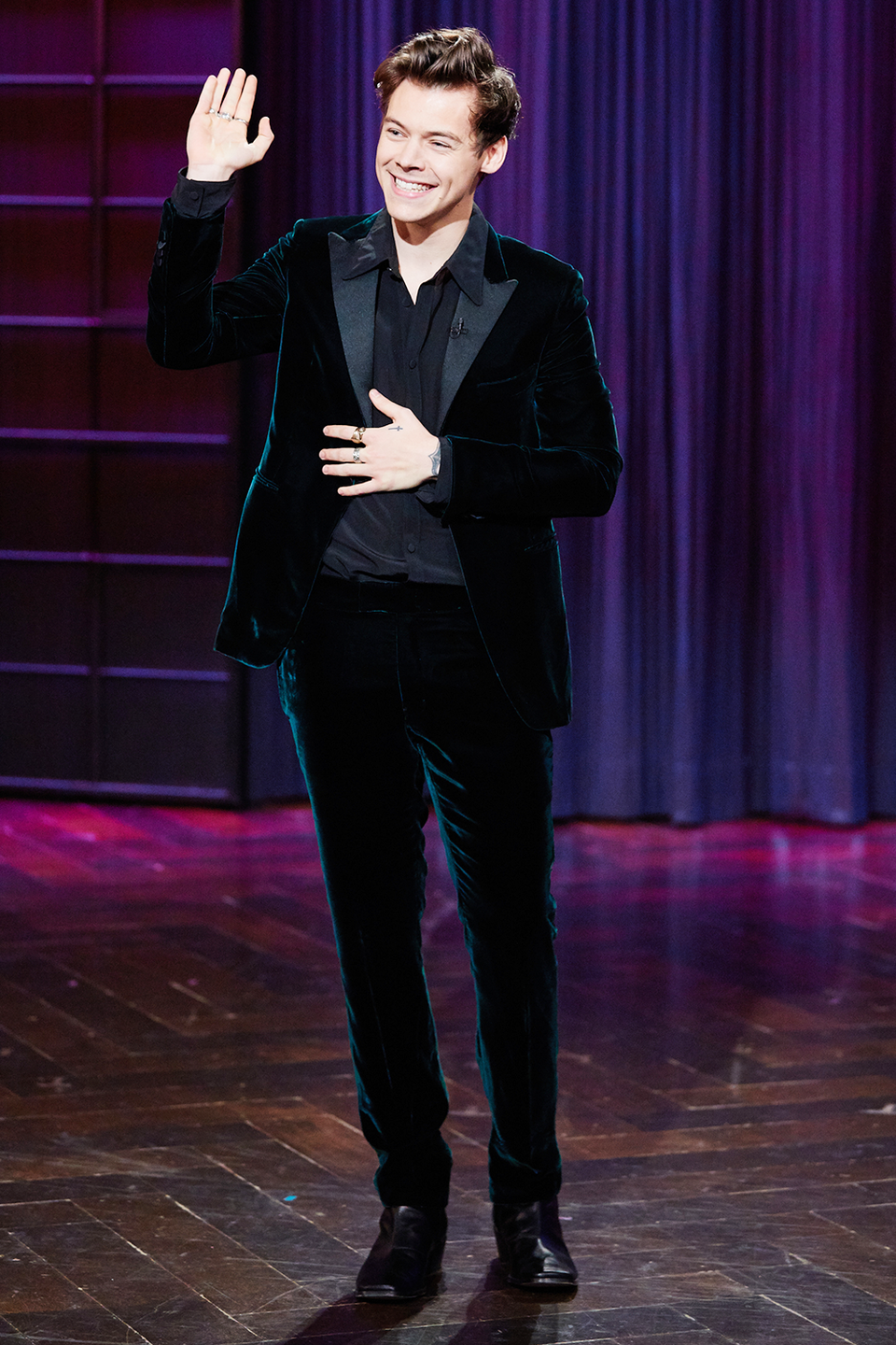 <p>Once again, just when you think he's toning it down, you realize he's wearing head-to-toe deep green velvet. This man is a treasure.</p>