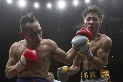 Japan's Naoya Inoue, right, gets a punch from Philippines' Nonito Donaire in the 11th round of their World Boxing Super Series bantamweight final match in Saitama, Japan, Thursday, Nov. 7, 2019. Inoue beat Donaire with a unanimous decision to win the championship. (AP Photo/Toru Takahashi)