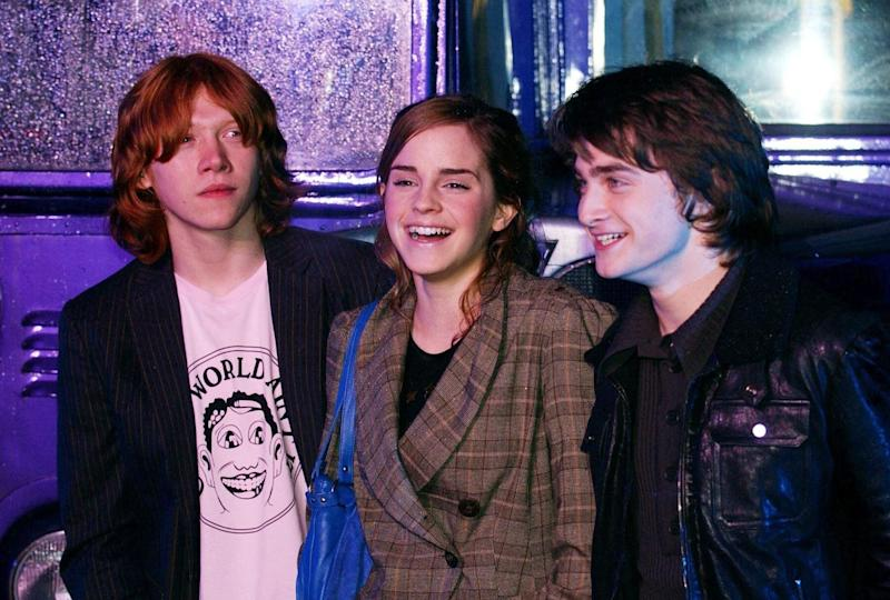 (From left to right) Rupert Grint (Ron), Emma Watson (Hermione), and Daniel Radcliffe (Harry) arrive for the Global DVD & VHS Launch party of Harry Potter And The Prisoner Of Azkaban, at Middle Temple in central London (Photo by PA Images via Getty Images)