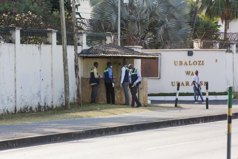 Tanzanian security officers guard an entrance to the French embassy after an attacker wielding an assault rifle was killed in the Salenda area of Dar es Salaam