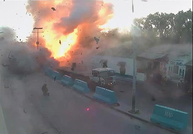 <p>A video grab taken from a Somali police CCTV, date shot May 24, 2017, shows the moment a car explodes near the Mogadishu seaport in Somalia. (Photo: Somali Police/Reuters) </p>